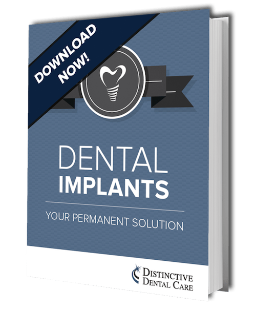 Preview image of your free dental implants ebook from the experts in Prescott family dentistry