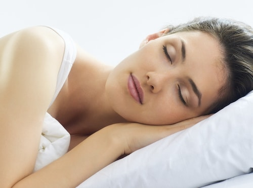 A woman sleeping soundly shows how Sedation Dentistry can put you at ease