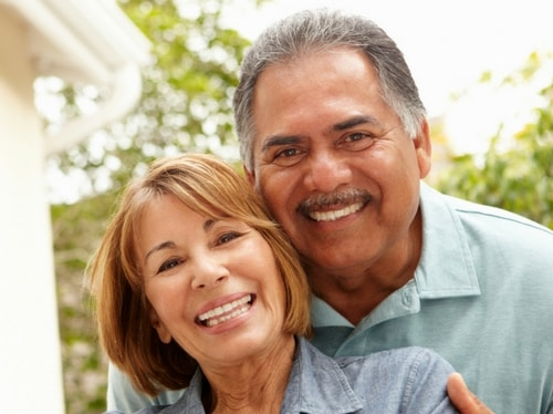 An older couples smiles to show how Dental Implants restore your smile