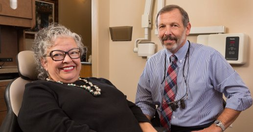 Dr. Wullf with an actual patient in a treatment room in his office showing off her dazzling white smile thanks to our teeth whitening in Prescott, AZ